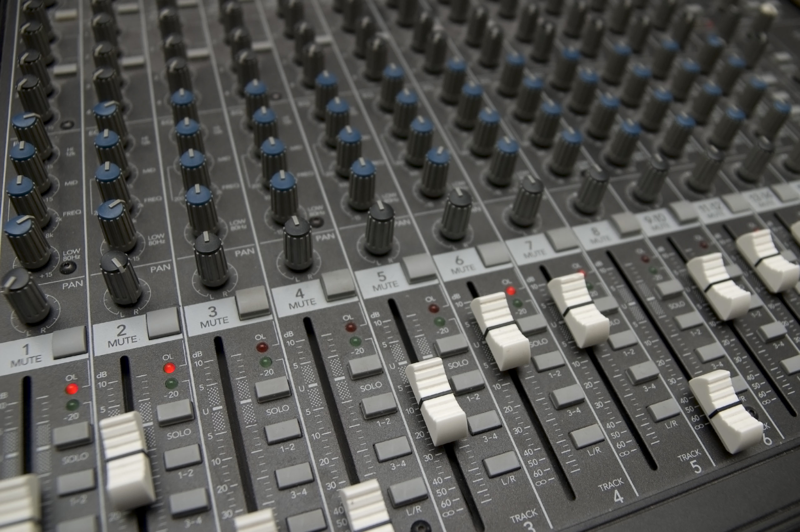 closeup view of a DJ's mixing desk with shallow depth of field